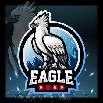 Design do logotipo do mascote da águia harpia e esport