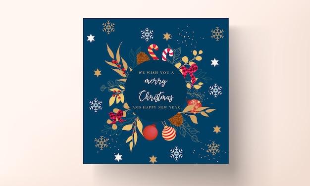 Design luxuoso de cartão de feliz natal dourado e vermelho