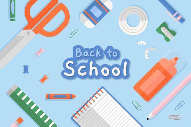 Design plano de volta ao fundo da escola com artigos de papelaria