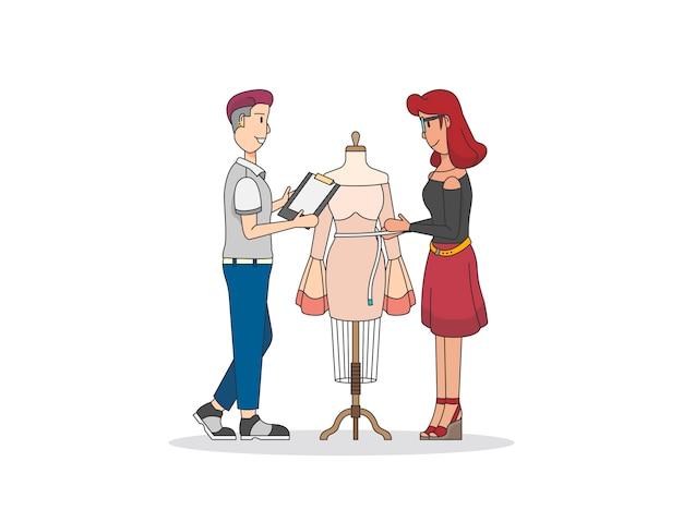 Designers de moda trabalhando em um manequim manequim