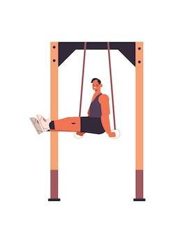 Desportista fazendo exercícios abdominais, homem exercitando-se na barra, malhando na academia, treinamento físico, estilo de vida saudável, conceito vertical