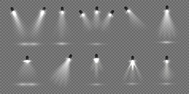 Destaque para o palco. conjunto de holofote realista. projectores de estúdio iluminados para o palco. efeito de iluminação de palco de ilustração vetorial para cenário de teatro ou concerto