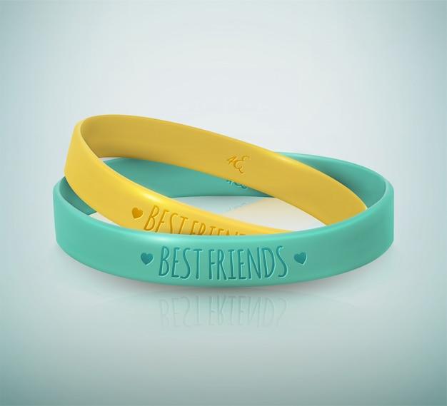 Dia da amizade, feliz feriado da amizade. duas pulseiras de borracha para melhores amigas