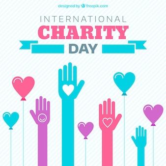 Dia da caridade com as mãos e os corações