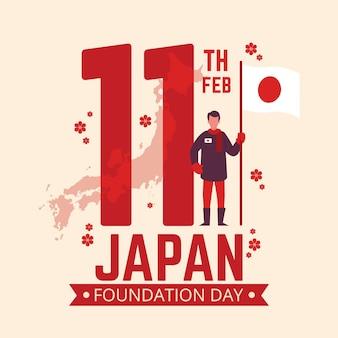 Dia da fundação homem segurando bandeira no japão