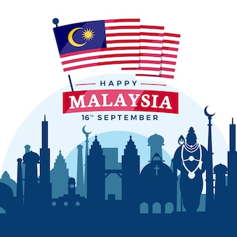 Dia da malásia com sua bandeira na cidade