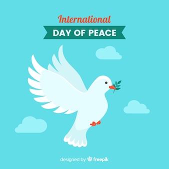 Dia da paz composição com pomba branca plana