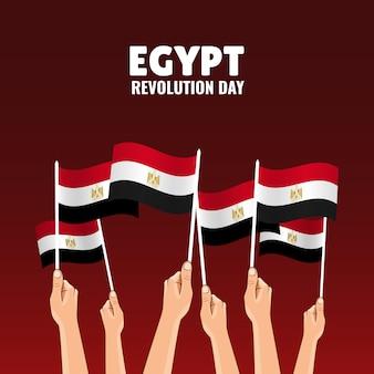 Dia da revolução no egito. as mãos seguram as bandeiras do país