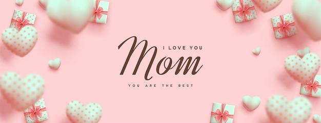 Dia das mães com caixas de presente e lindos balões rosa.