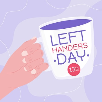 Dia de canhotos com a mão segurando a caneca
