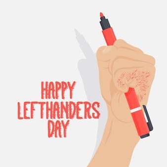 Dia de canhotos com a mão segurando a caneta