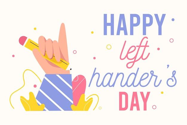 Dia de canhotos com a mão segurando o lápis