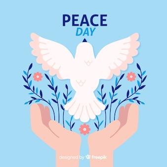Dia de paz de design plano com uma pomba