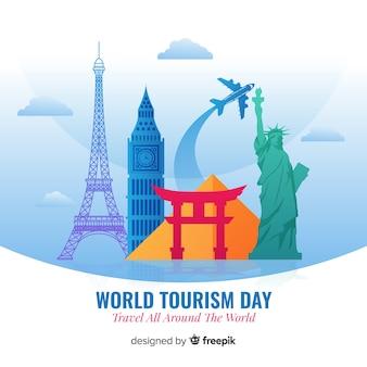 Dia de turismo de design plano com marcos