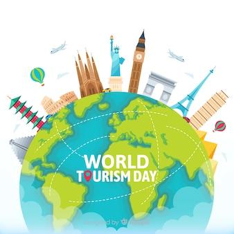 Dia de turismo mundial plano com marcos e transporte