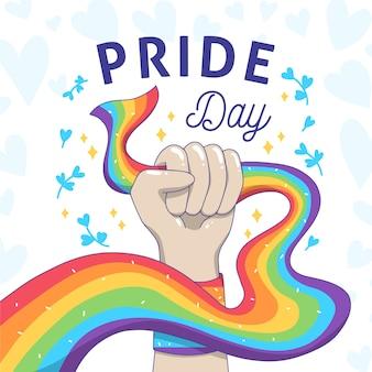 Dia do orgulho e punho forte segurando a bandeira