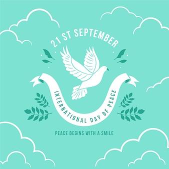 Dia do pombo da paz com folhas de oliveira