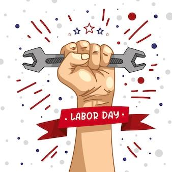 Dia do trabalho com a mão segurando a ferramenta