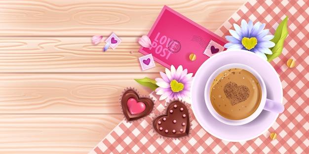 Dia dos namorados amor banner com vista superior de mesa de madeira, xícara de café, camomila, envelope rosa. café da manhã de férias românticas de primavera com bolos de chocolate.