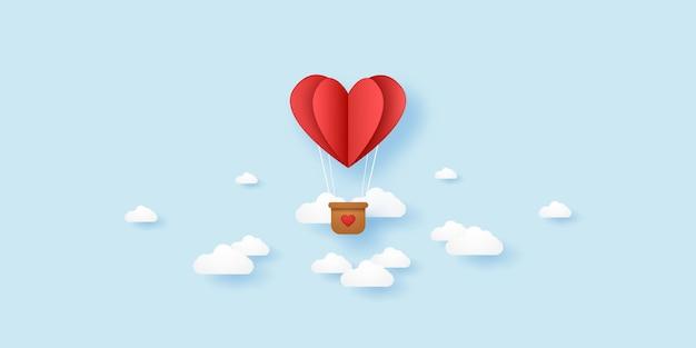 Dia dos namorados balão de ar quente com coração dobrado vermelho voando no céu estilo de arte de papel