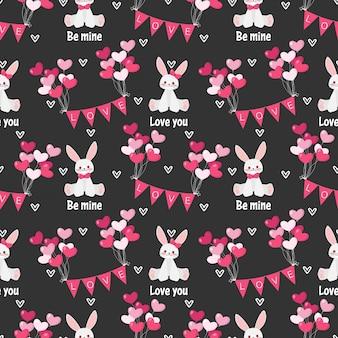 Dia dos namorados sem costura padrão com coelho cute.