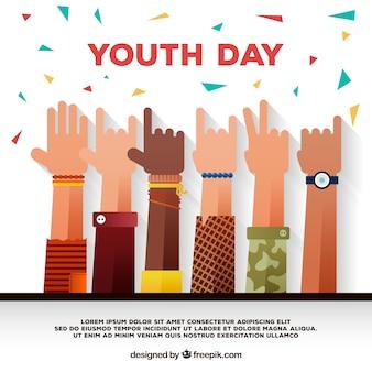 Dia feliz da juventude com mãos e confetes