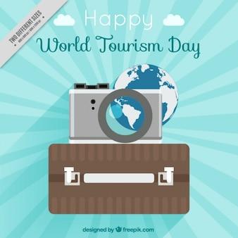 Dia feliz turismo com mala de viagem e câmera
