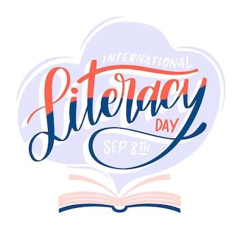 Dia internacional da alfabetização desenhada mão com livro