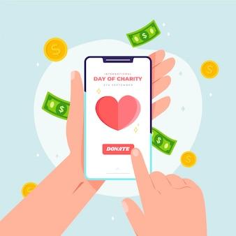 Dia internacional da caridade, segurando um telefone móvel