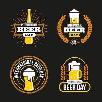 Dia internacional da cerveja emblemas em design plano