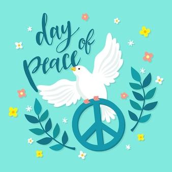 Dia internacional da paz com pomba e símbolo da paz