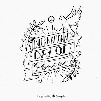 Dia internacional da paz composição mão desenhada lettering