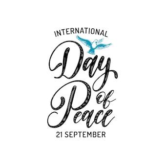 Dia internacional da paz, letras de mão, ilustração de pomba com um galho de palmeira em fundo branco.