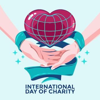 Dia internacional de caridade com as mãos e o coração
