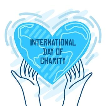 Dia internacional de caridade mãos segurando um coração
