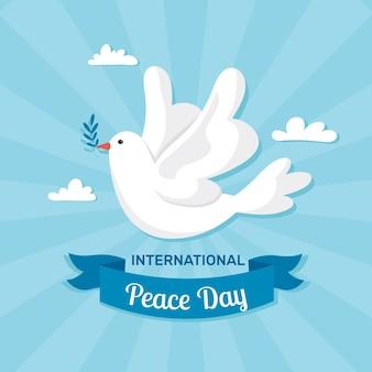 Dia internacional do design plano do pássaro da paz ilustrado