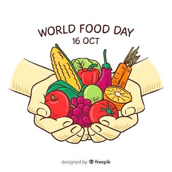 Dia mundial da comida com pessoa segurando legumes