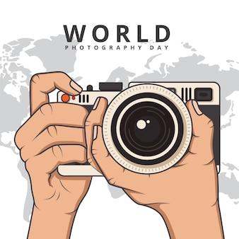 Dia mundial da fotografia com as mãos segurando a câmera