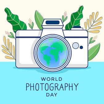 Dia mundial da fotografia com folhas e câmera
