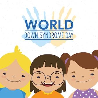 Dia mundial da síndrome de down com as mãos estampadas tinta e grupo de meninas