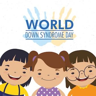 Dia mundial da síndrome de down com as mãos estampadas tinta e meninas