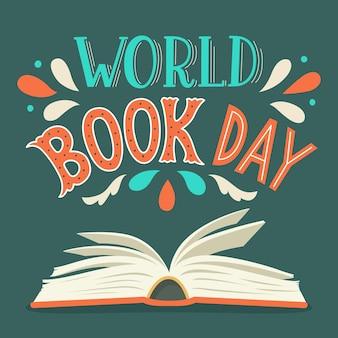 Dia mundial do livro. abra o livro com letras desenhadas à mão.