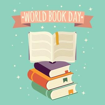 Dia mundial do livro, livro aberto com bandeira festiva e pilha de livros