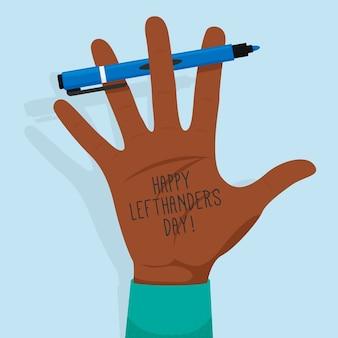 Dia para canhotos com mão e caneta