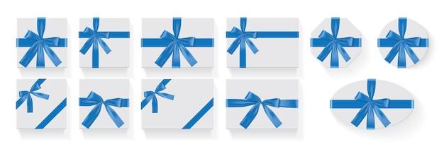 Diferentes formas de caixas com um laço azul