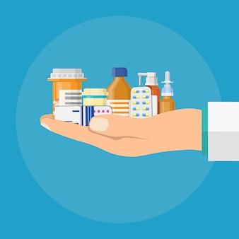 Diferentes pílulas médicas e frascos nas mãos do médico,