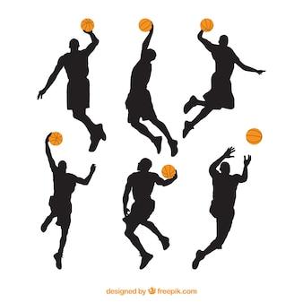 Diferentes silhuetas de jogadores de basquete