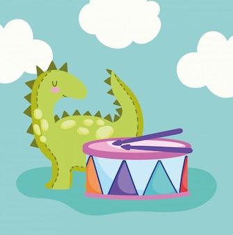 Dinossauro pequeno e tambor musical
