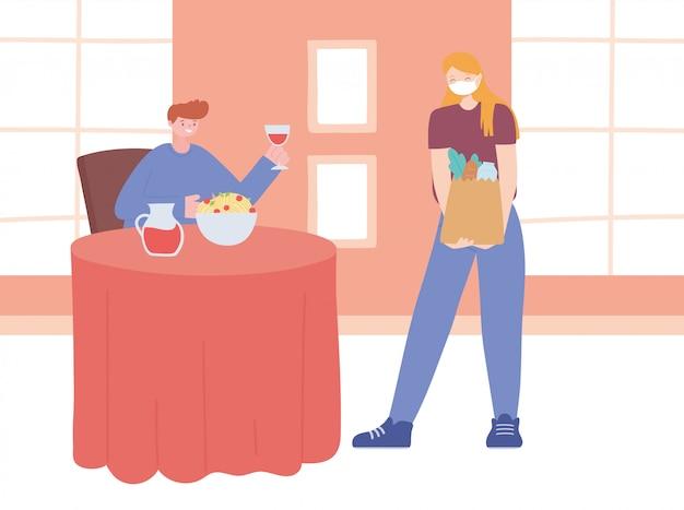 Distanciamento social do restaurante, homem comendo e mulher com saco de compras distância um do outro, pandemia
