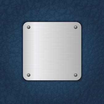 Distintivo de metal no fundo de couro